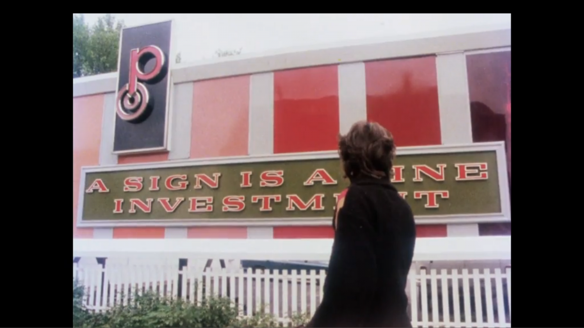 Sign is a Fine Investment by Judith Williamson, 1983
